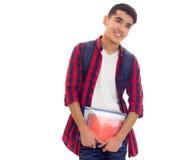 Młody człowiek z plecakiem i zeszytami Obraz Stock