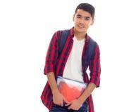 Młody człowiek z plecakiem i zeszytami Zdjęcie Royalty Free