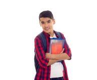 Młody człowiek z plecakiem i zeszytami Zdjęcie Stock