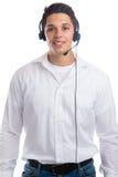 Młody człowiek z słuchawki telefonu rozmowy telefonicza centrum agenta biznesem Fotografia Royalty Free