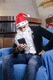 Młody człowiek z Santa kostiumem Zdjęcia Stock