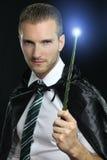 Młody czarownik trzyma magiczną różdżkę Obraz Stock