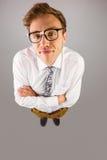 Młody geeky biznesmen patrzeje kamerę Obrazy Stock