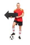 Młody gracz futbolu trzyma strzała Obraz Royalty Free
