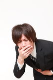 Młody Japoński biznesmen czuje jak buchanie zdjęcie stock