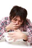 Młody Japoński mężczyzna czuje jak buchanie zdjęcie stock