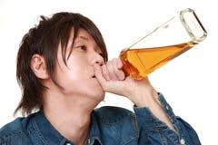 Młody Japoński mężczyzna pijący zbyt dużo obraz stock