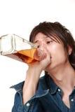 Młody Japoński mężczyzna pijący zbyt dużo obrazy stock