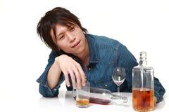 Młody Japoński mężczyzna pijący zbyt dużo fotografia stock
