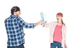 młody krzyczący mężczyzny bój z dziewczyną farba rolownikami zdjęcia royalty free
