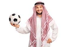 Młody męski arab trzyma futbol Obrazy Royalty Free