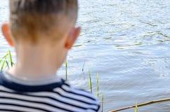 Młody Męski dzieciaka połów przy rzeką Samotnie Fotografia Royalty Free