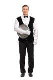 Młody męski kelner trzyma tacę Obrazy Royalty Free