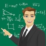 Młody męski nauczyciel matematyki z kawałkiem kredy pozycja obok blackboard Obraz Royalty Free