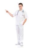Młody męski pielęgniarki wskazywać Obraz Royalty Free