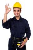 Młody męski pracownik daje ok znakowi Zdjęcie Stock