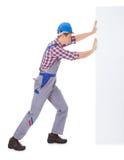 Młody Męski pracownika dosunięcia plakat Obrazy Stock