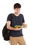 Młody męski student collegu z książkami Zdjęcie Stock