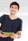Młody męski student collegu z książkami Zdjęcia Stock