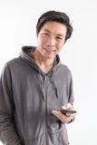 Młody męski używa smartphone Fotografia Stock