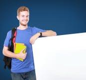 Młody męski uczeń trzyma białą puste miejsce deskę Zdjęcia Royalty Free