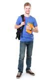 Młody męski uczeń z książkami Fotografia Stock