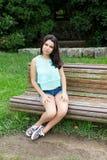 Młody nastolatek przy parkiem Zdjęcie Stock