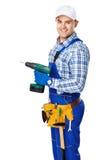 Młody pracownik budowlany z elektrycznym świderem Zdjęcia Stock