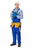 Młody pracownik budowlany z elektrycznym świderem Fotografia Stock