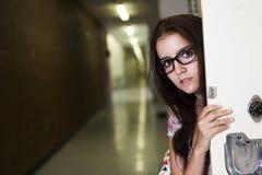 Młody przystojny żeński uczeń przy szkołą wyższa Fotografia Stock