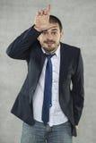 Młody przystojny biznesmen żartuje z ludźmi fotografia royalty free