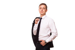 Młody przystojny biznesmen trzyma kurtkę w jego jeden ręce i innej ręce w jego kieszeni portret odizolowywający dalej Obraz Stock