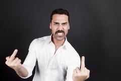 Młody przystojny mężczyzna seans pieprzy z ręka gesta Fotografia Royalty Free