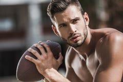 Młody przystojny męski gracz futbolu z piłką Obraz Royalty Free