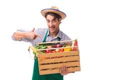 Młody rolnik z świeżym produkt spożywczy odizolowywającym na białym tle zdjęcie royalty free