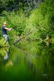 Młody rybak Łapie dużej ryba obraz royalty free