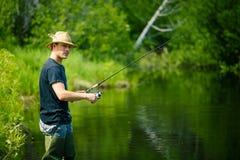 Młody rybaka połów z cierpliwością zdjęcie stock