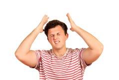Młody smutny thoughful mężczyzna ma migrenę po pracy emocjonalny mężczyzna odizolowywający na białym tle zdjęcia stock