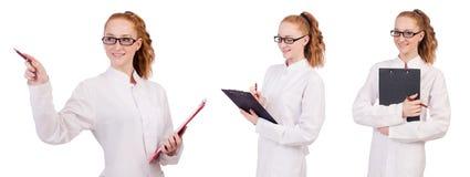 Młody studenta medycyny writing na segregatorze odizolowywającym na whit zdjęcia stock