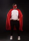 Młody super bohatera mężczyzna w studiu Zdjęcia Stock