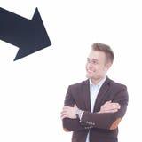 Młody uśmiechnięty mężczyzna mienia pustego miejsca pointer obraz royalty free