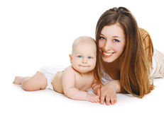 Młody uśmiechnięty mamy i cukierki dziecko wpólnie Obraz Stock