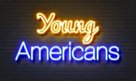 Młodych amerykan neonowy znak na ściana z cegieł tle Zdjęcia Stock