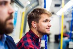 Młodzi człowiecy w metrze Fotografia Royalty Free
