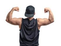 Młodzi mięśniowi facetów przedstawienia zbroją mięśnie - bicepsy Obraz Royalty Free