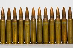 M-16 5. 56mm cartridges. A row of M-16 5. 56mm cartridges Royalty Free Stock Photography