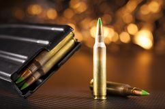 M855 ammo and magazine. For an assault rifle with orange behind Stock Images