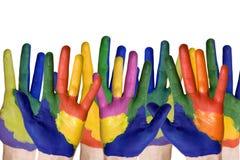 målade grupphänder Arkivfoto