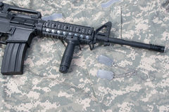 M4 carbine with blank dog tags Royalty Free Stock Photos