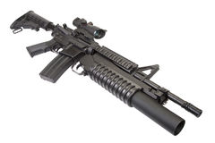 An M4A1 carbine equipped with an M203 grenade launcher. Isolated on white stock photography
